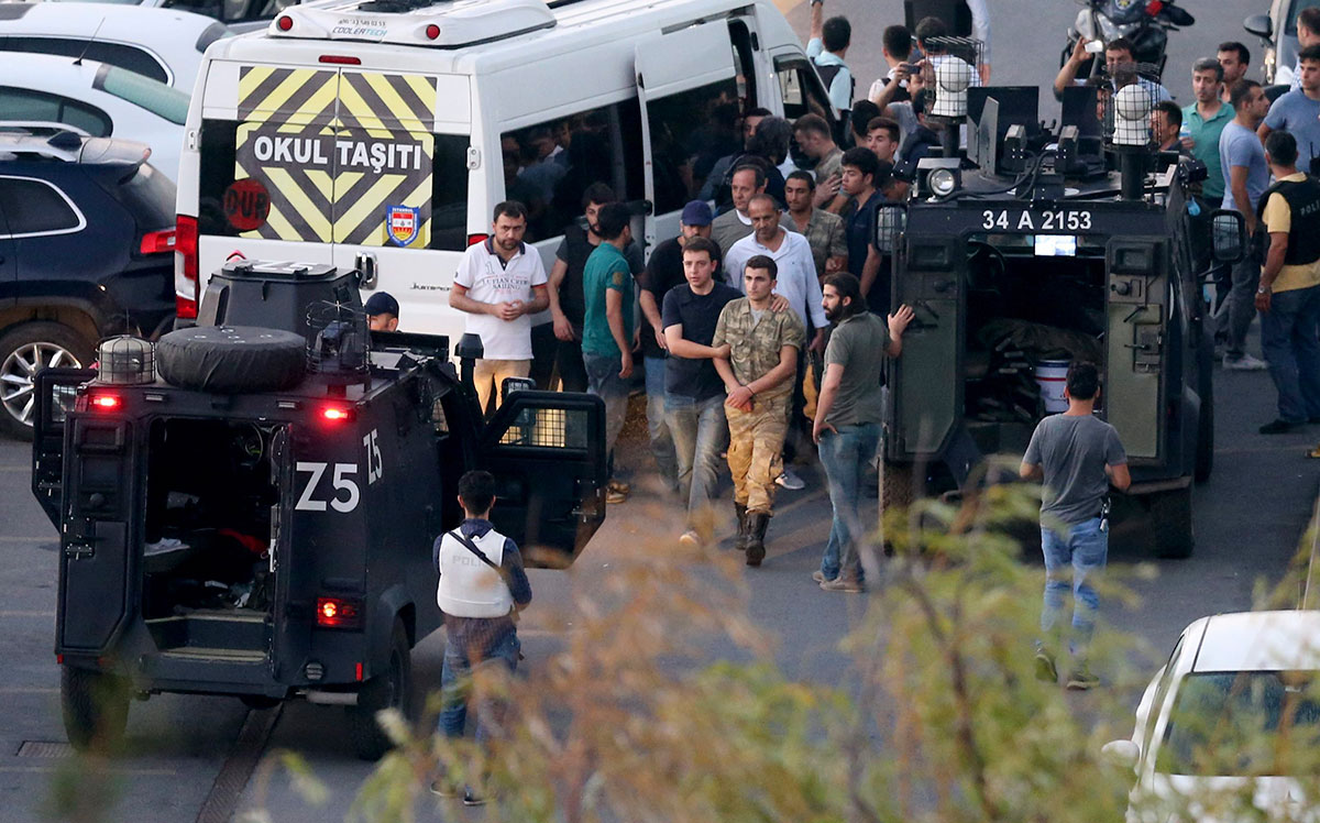Turkish police arrest soldiers involved in the coup at Taksim Square.