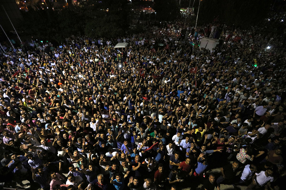 People demonstrate outside the Ataturk international airport in Istanbul