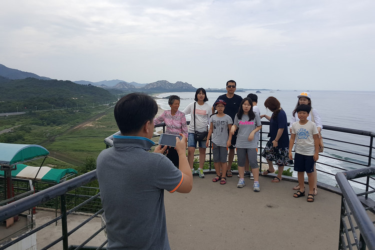 """Family visiting the DMZ for the """"Pokemon Tourism"""""""