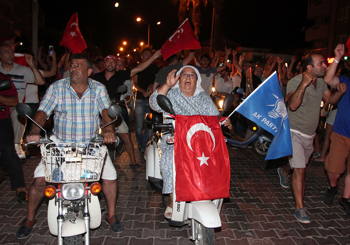 People march with Turkish flags in the resort town of Marmaris, where Erdogan was on holiday at the time of the attempted coup.