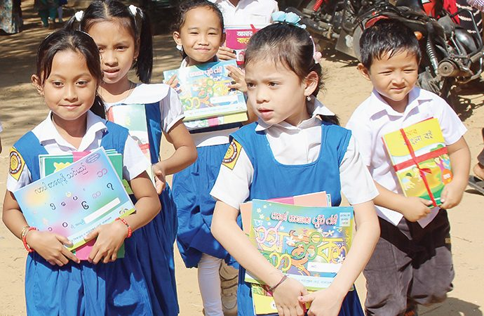 Indigenous students of Bangladesh get books in mother tongue